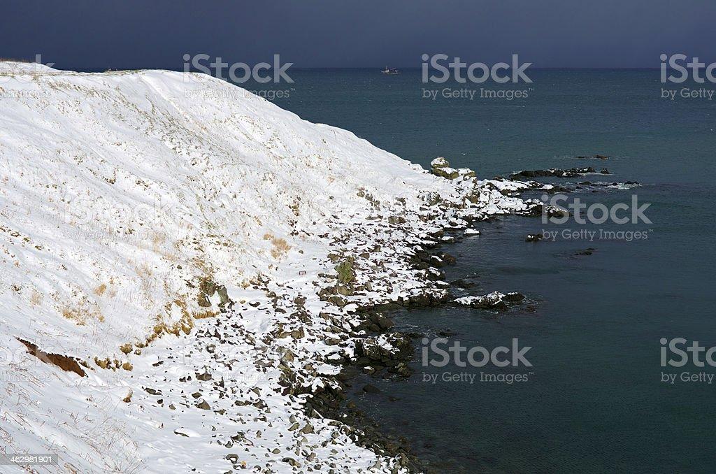 Snow stone ridge beach stock photo