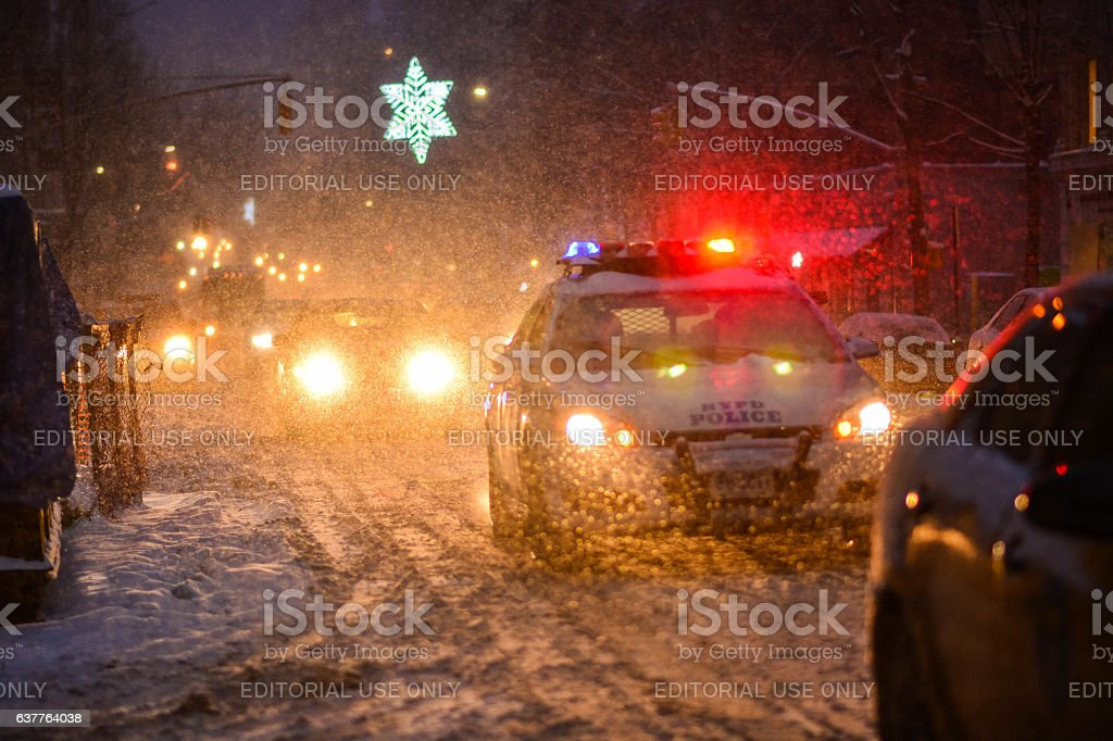 Snow storm in NYC manhattan police on park ave stock photo