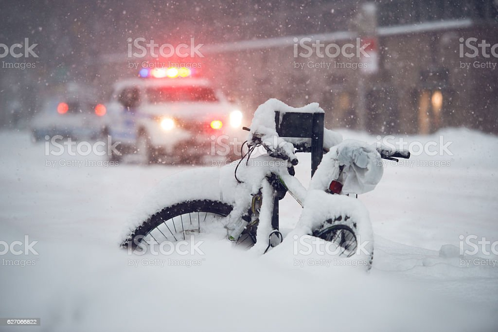 Snow storm in the city. Police car run emergency call stock photo