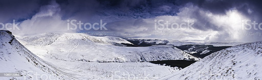 Snow storm white wilderness dramatic skies Welsh landscape panorama UK stock photo