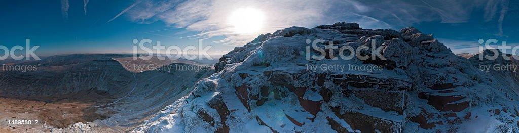 Snow summit sun flare vista stock photo