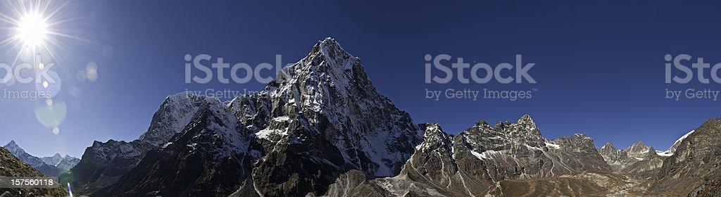 Snow summit sunburst Himalaya mountain peaks high altitude wilderness panorama royalty-free stock photo