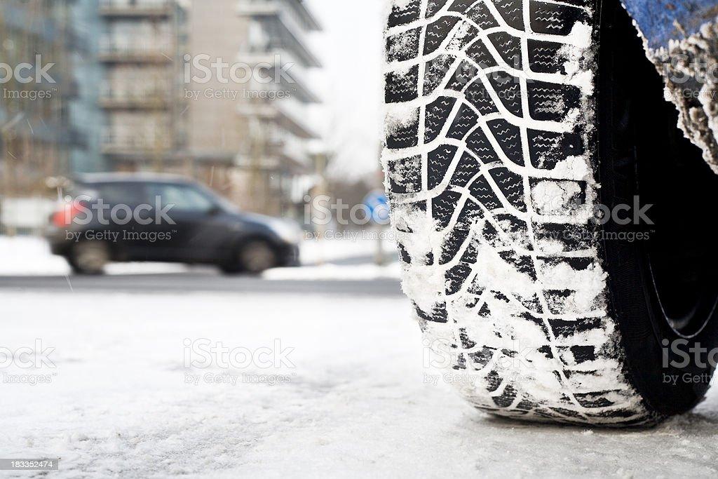 Snow tire, winter road conditions stock photo