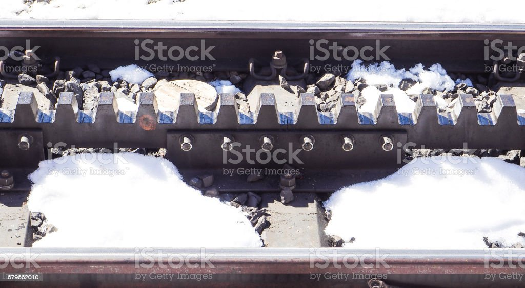 snow toothed wheel gear railway at Jungfrau stock photo