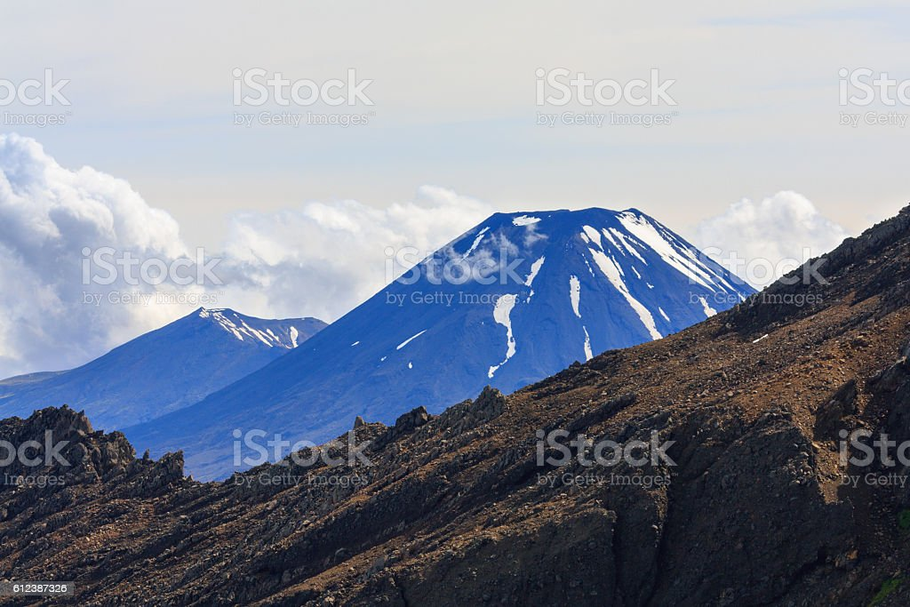 Snow top of Ngauruhoe volcano in Tongariro National Park stock photo