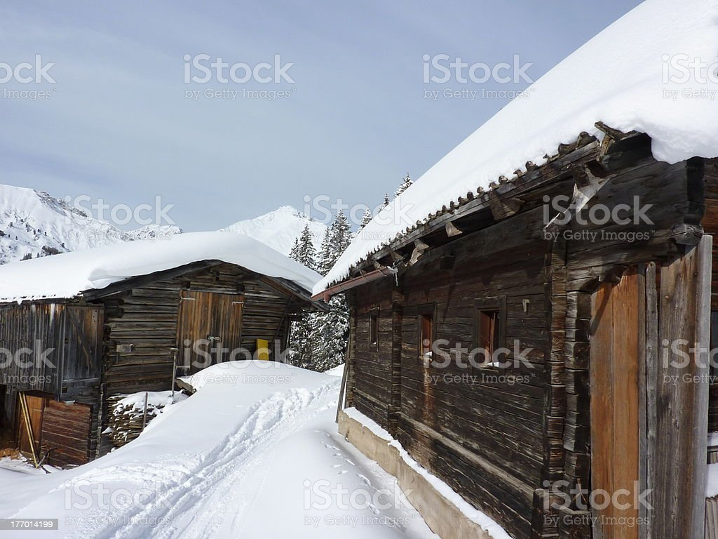 Snow track through the mountain huts in Tyrol stock photo