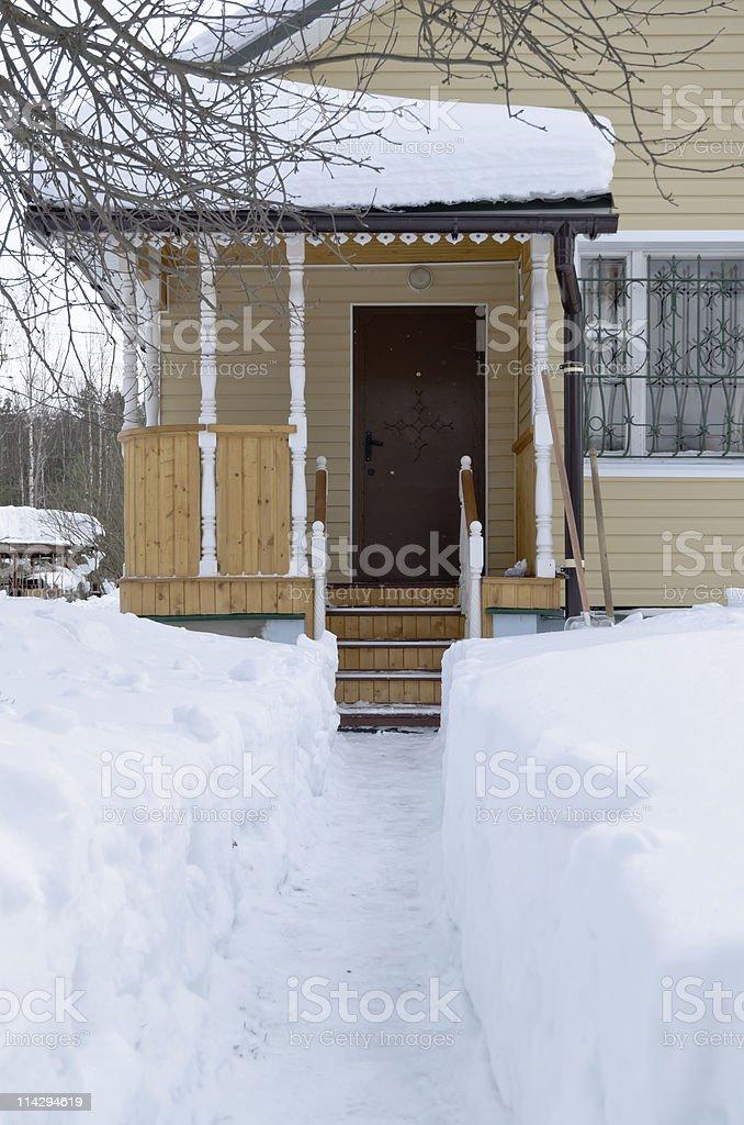 Snow track to the cottage door stock photo