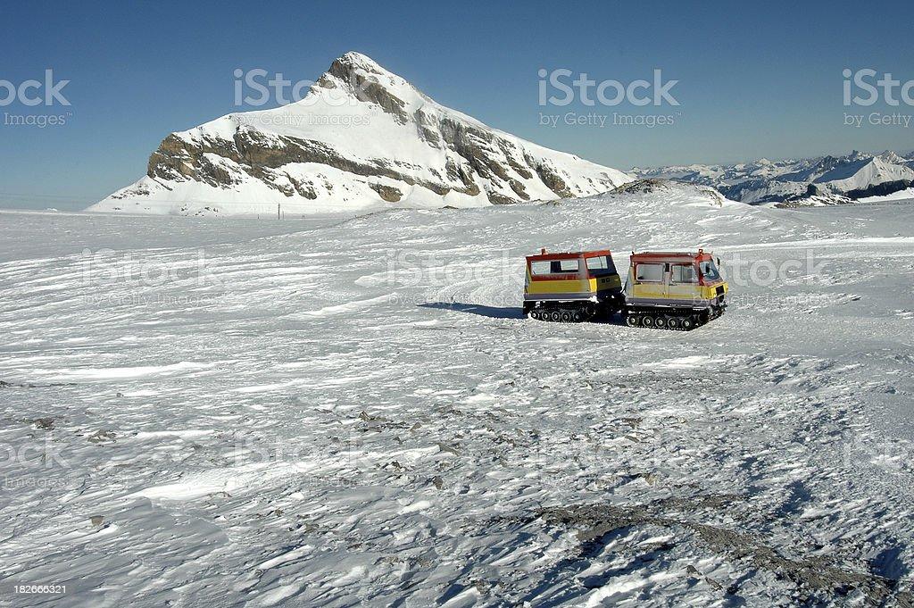 Snow truck Alps royalty-free stock photo