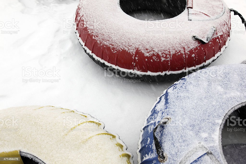 Snow Tubing on Mountian Slope. stock photo
