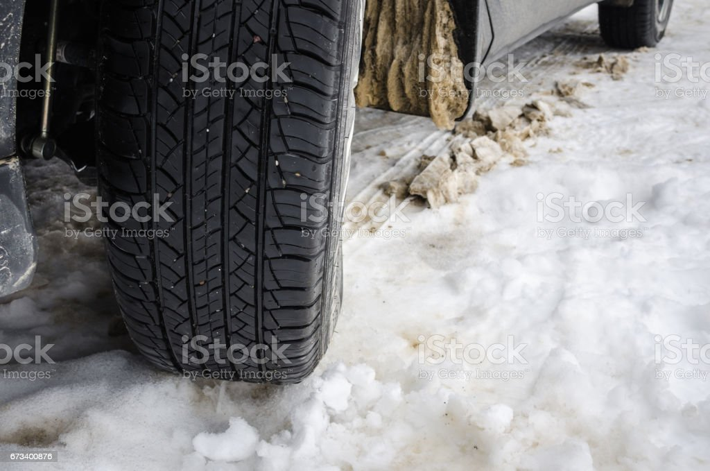 Snow Tyre on a Snowy Road stock photo