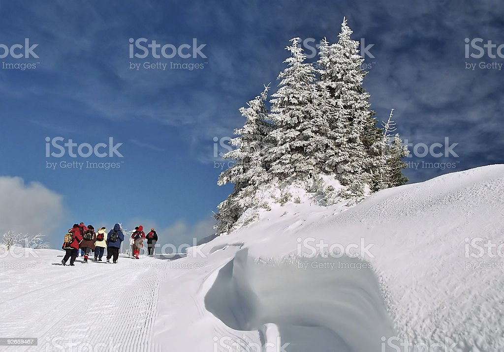 Snow wave with hikers in the background royalty-free stock photo