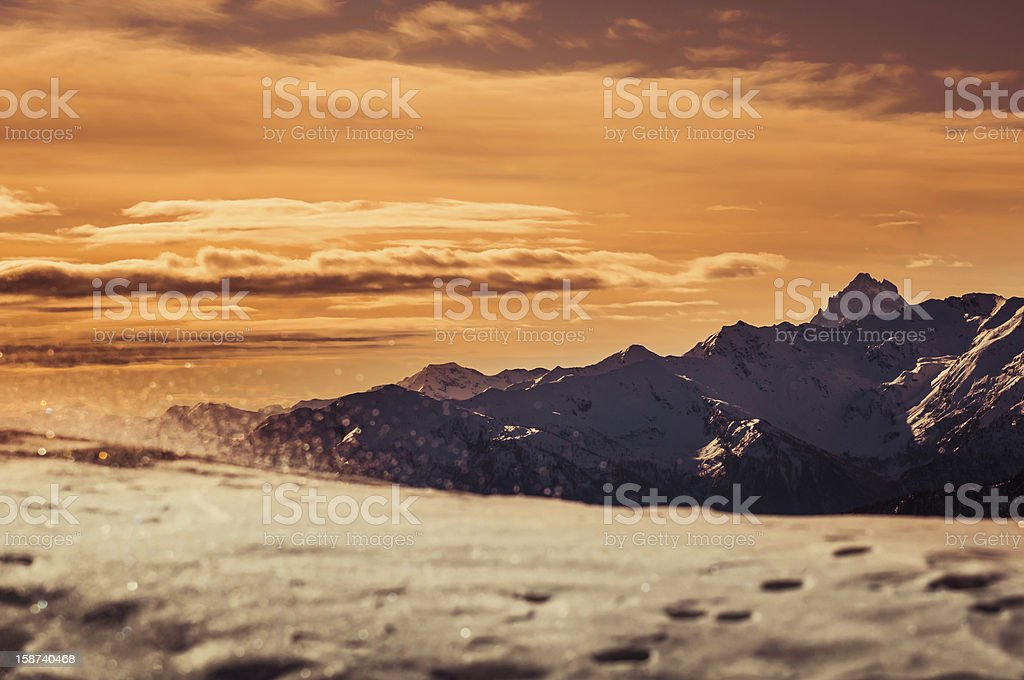Snow with Mountain Range at Sunset royalty-free stock photo