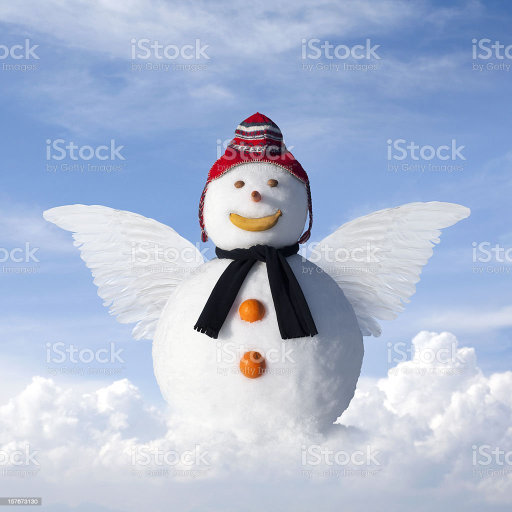 Snowangel. Snowman with wings on a cloud. stock photo