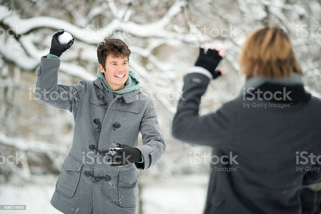 Snowball Fight, Friends outside in the Snow, Winter stock photo