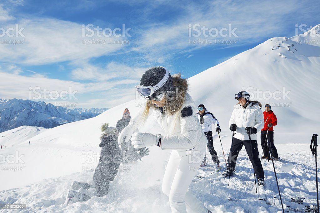 Snowball fight on the mountain top royalty-free stock photo