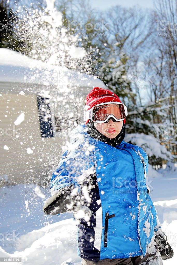 Snowball fight with young boy on the autism spectrum stock photo