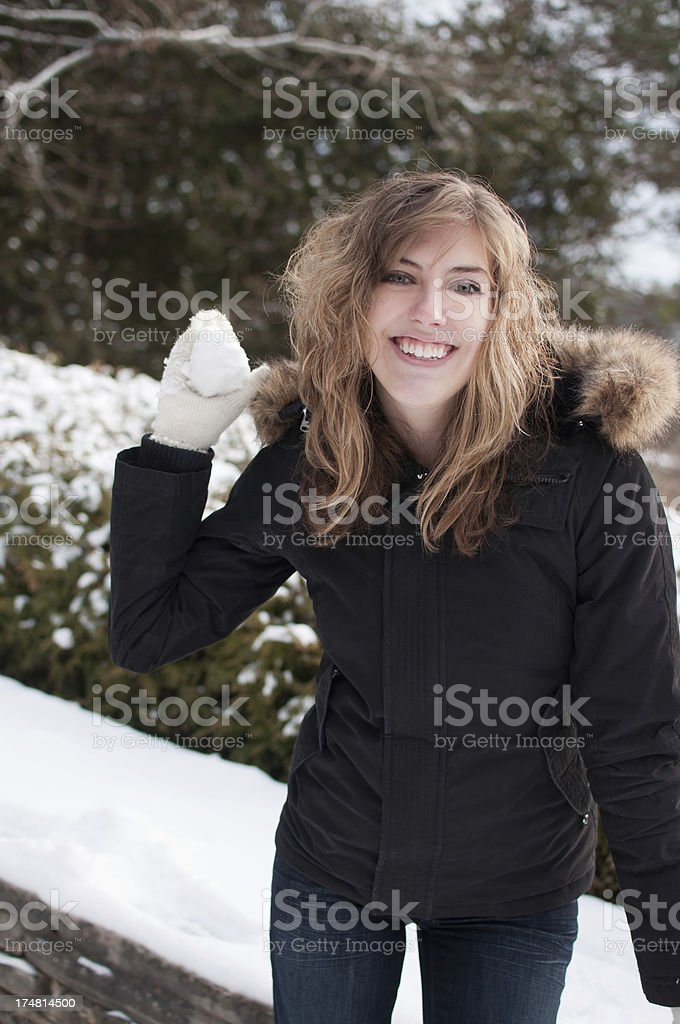 Snowball FIght! Young Adult in WInter royalty-free stock photo
