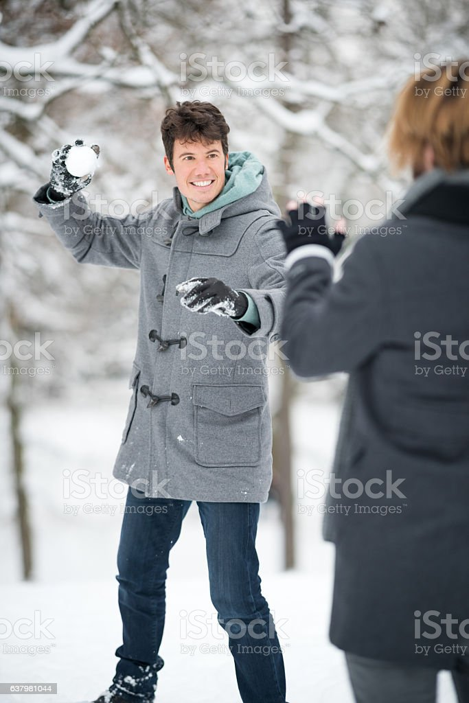 Snowball Fun, Friends outside in the Snow, Winter stock photo