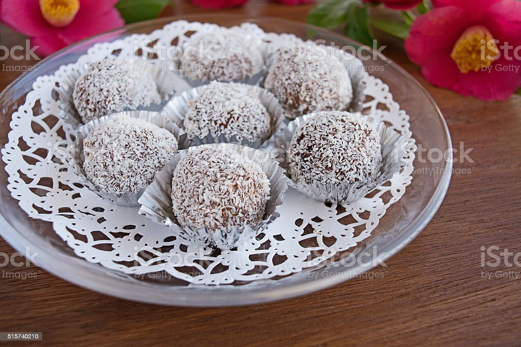 Snowball truffles of chocolate and coconut topping stock photo
