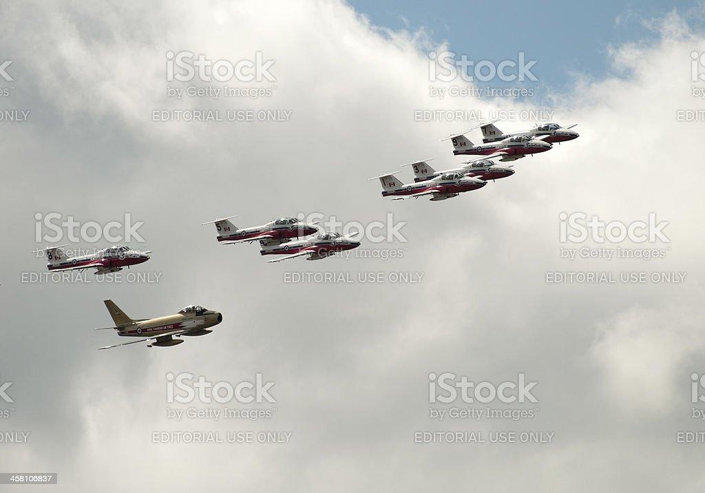 Snowbirds Fly With Golden Hawk stock photo