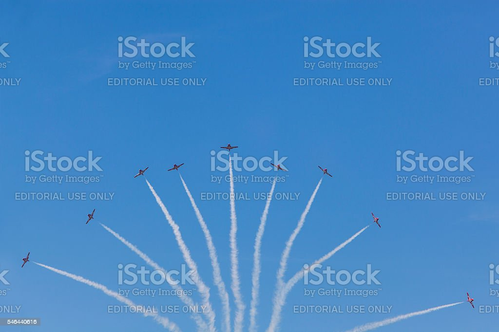 Snowbirds in blue sky stock photo