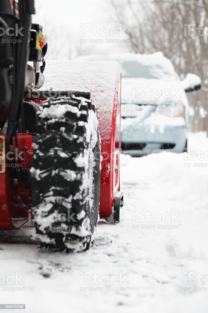 Snowblower Clearing Suburban Driveway royalty-free stock photo