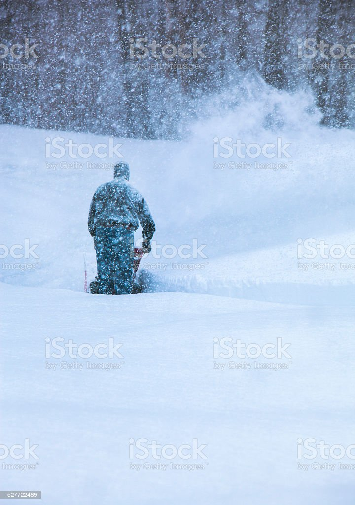 Snowblowing in a Blizzard stock photo