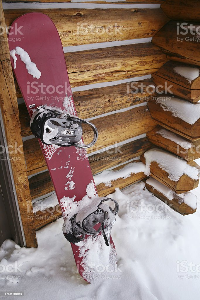 Snowboard And Log Cabin stock photo