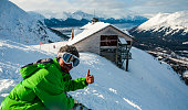 Snowboard Gives Thumbs Up For Good Snow Conditions