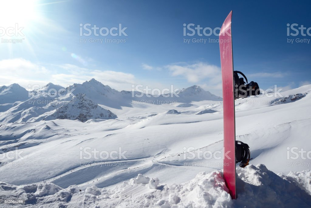 Snowboard in the snow stock photo