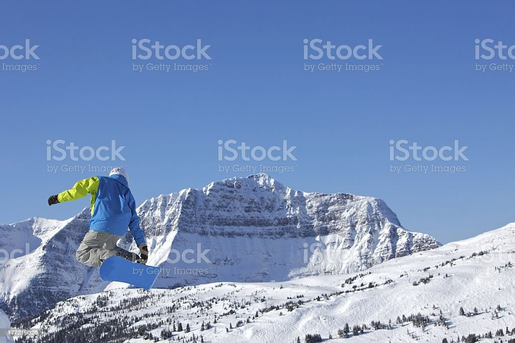 Snowboard Jump with The Monarch stock photo