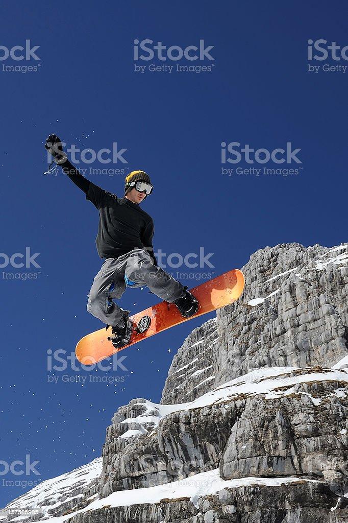 Snowboard jumping stock photo