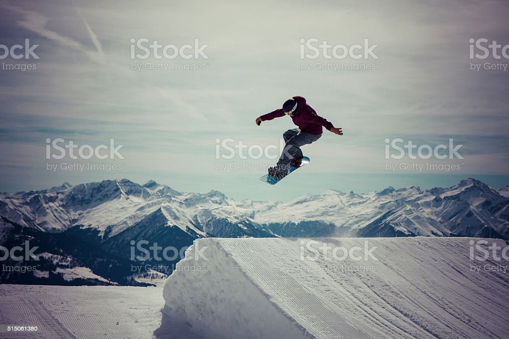 Snowboard jumps a 180 stock photo