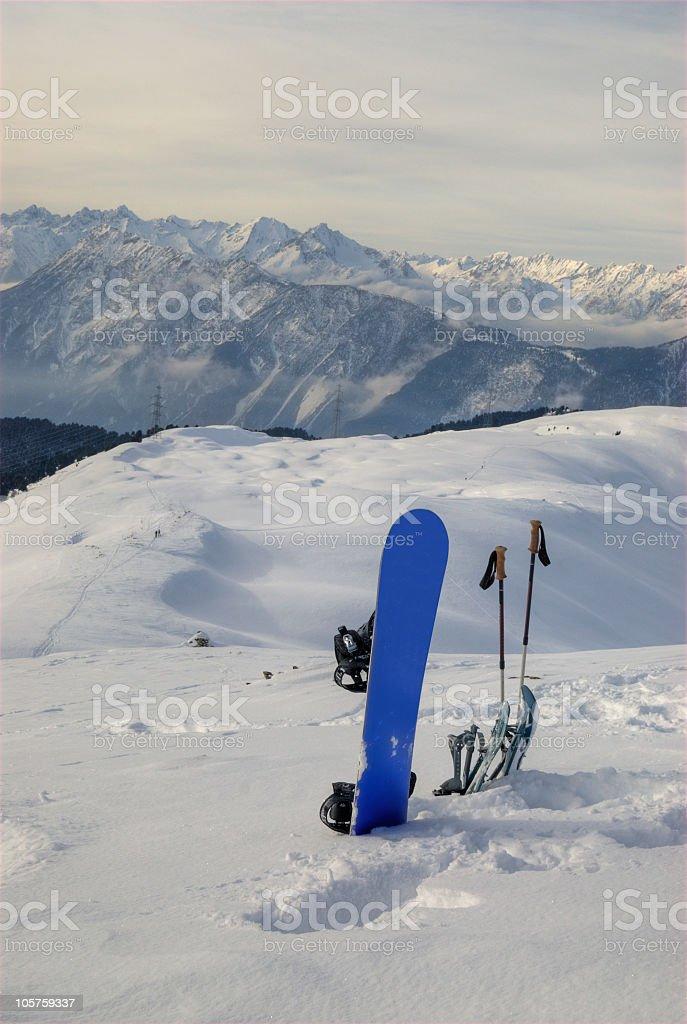 Snowboard Snowshoe Ski Sticks on a mountain royalty-free stock photo
