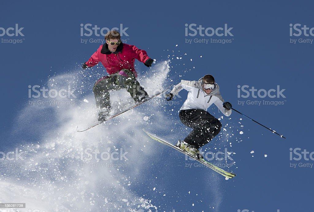 Snowboard vs. Ski Jump stock photo