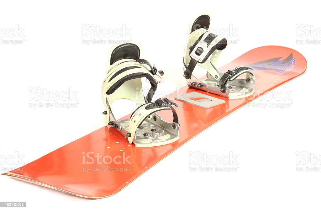 A snowboard with bindings against a white background stock photo