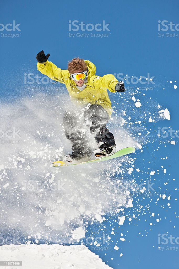 Snowboarder Airborne Against Clear Blue Sky royalty-free stock photo