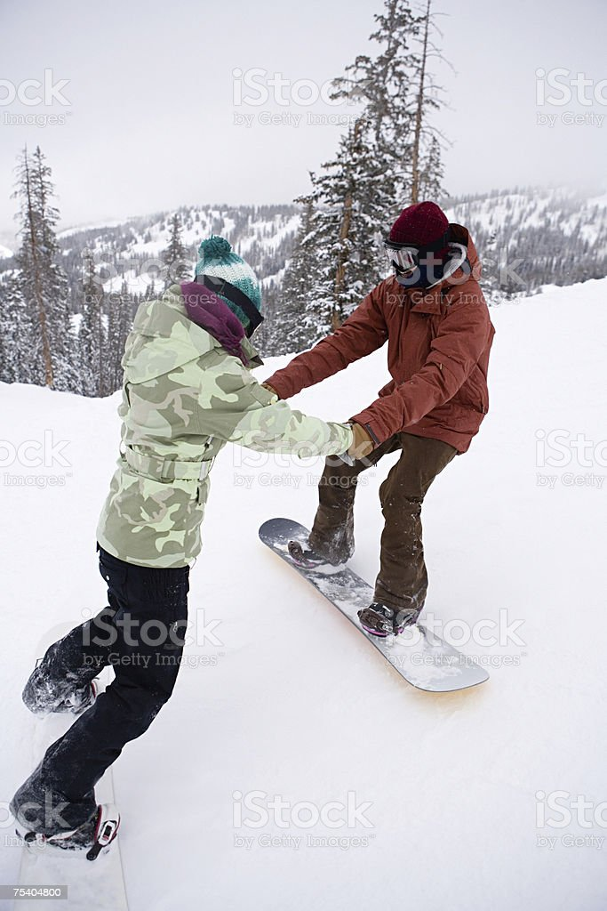 Snowboarder and instructor stock photo