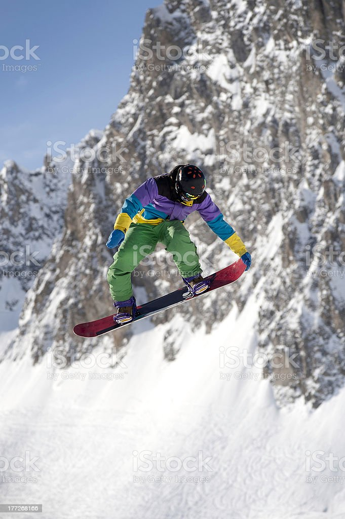 Snowboarder and mountain stock photo