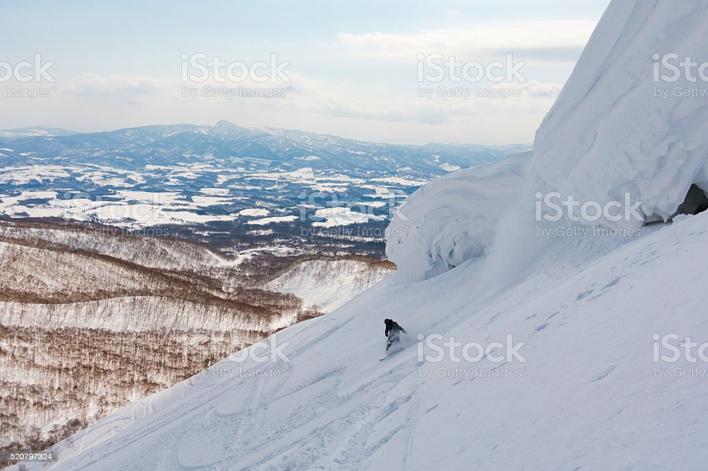 Snowboarder at a Ski Resort in Niseko, Hokkaido, Japan stock photo