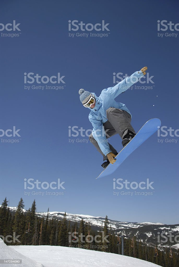 Snowboarder big air over a jump in Colorado stock photo