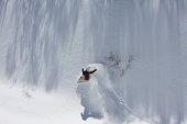 Snowboarder Carving a Powder Turn in Fresh Powder Snow