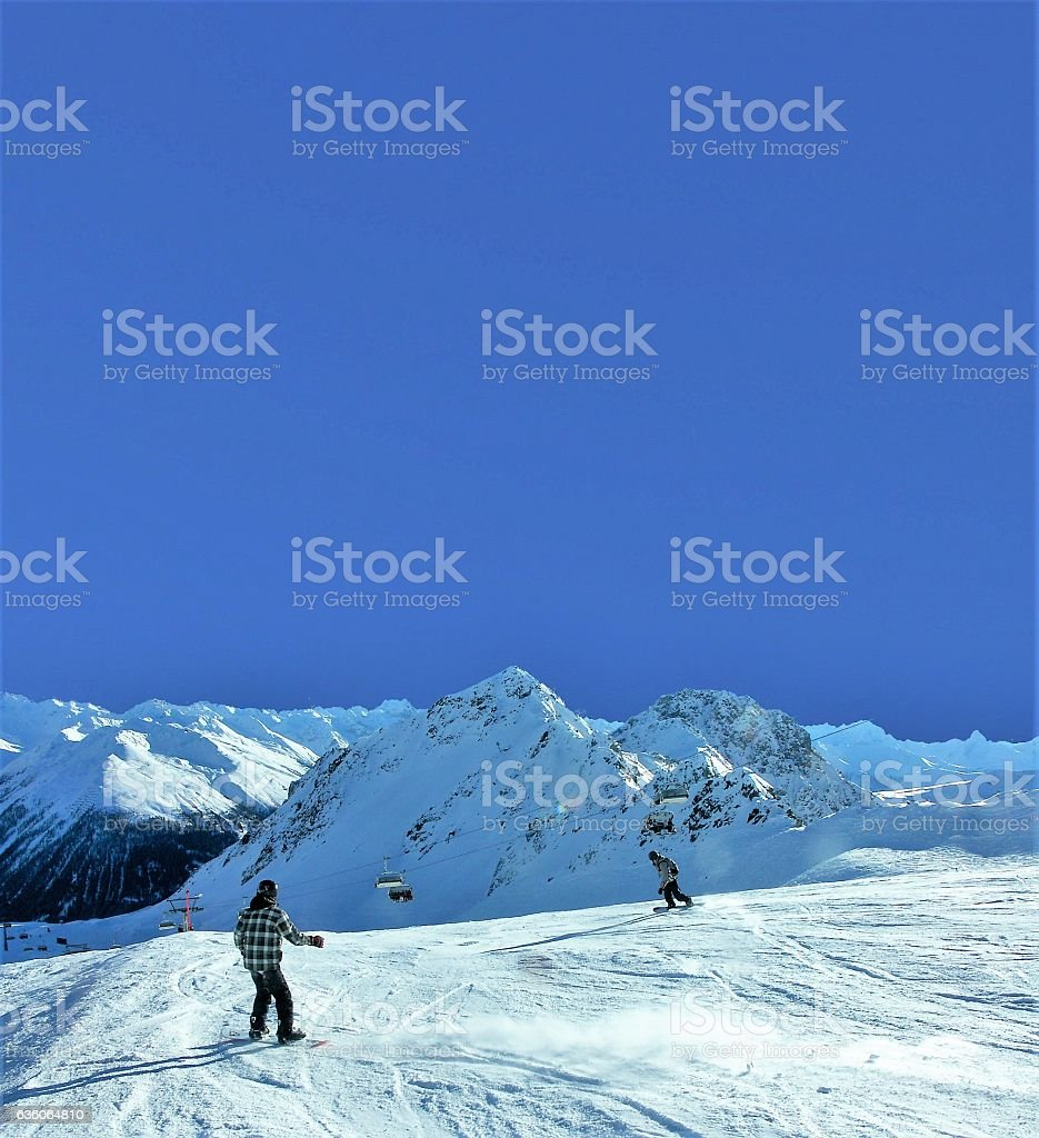 Snowboarder carving in powder stock photo