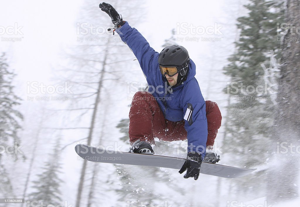 Snowboarder catching air royalty-free stock photo