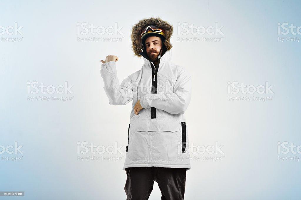 Snowboarder demonstrating bright anorak coat stock photo