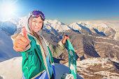 Snowboarder girl at Alps, Swiss mountain. Winter activities