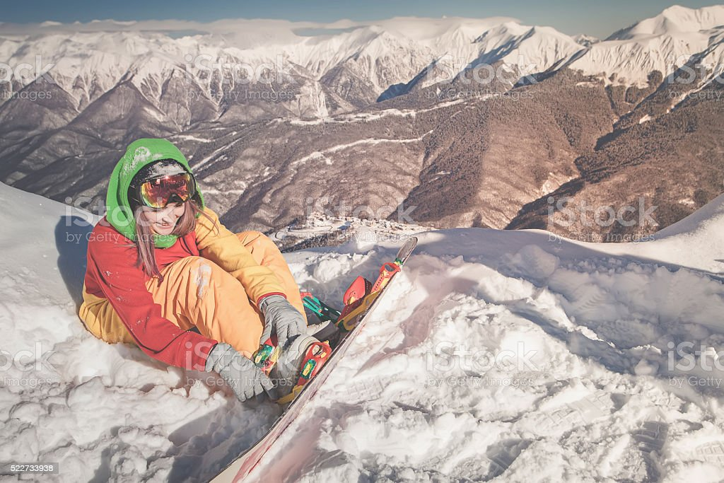 Snowboarder girl on the background of high mountain Alps, Switzerland stock photo