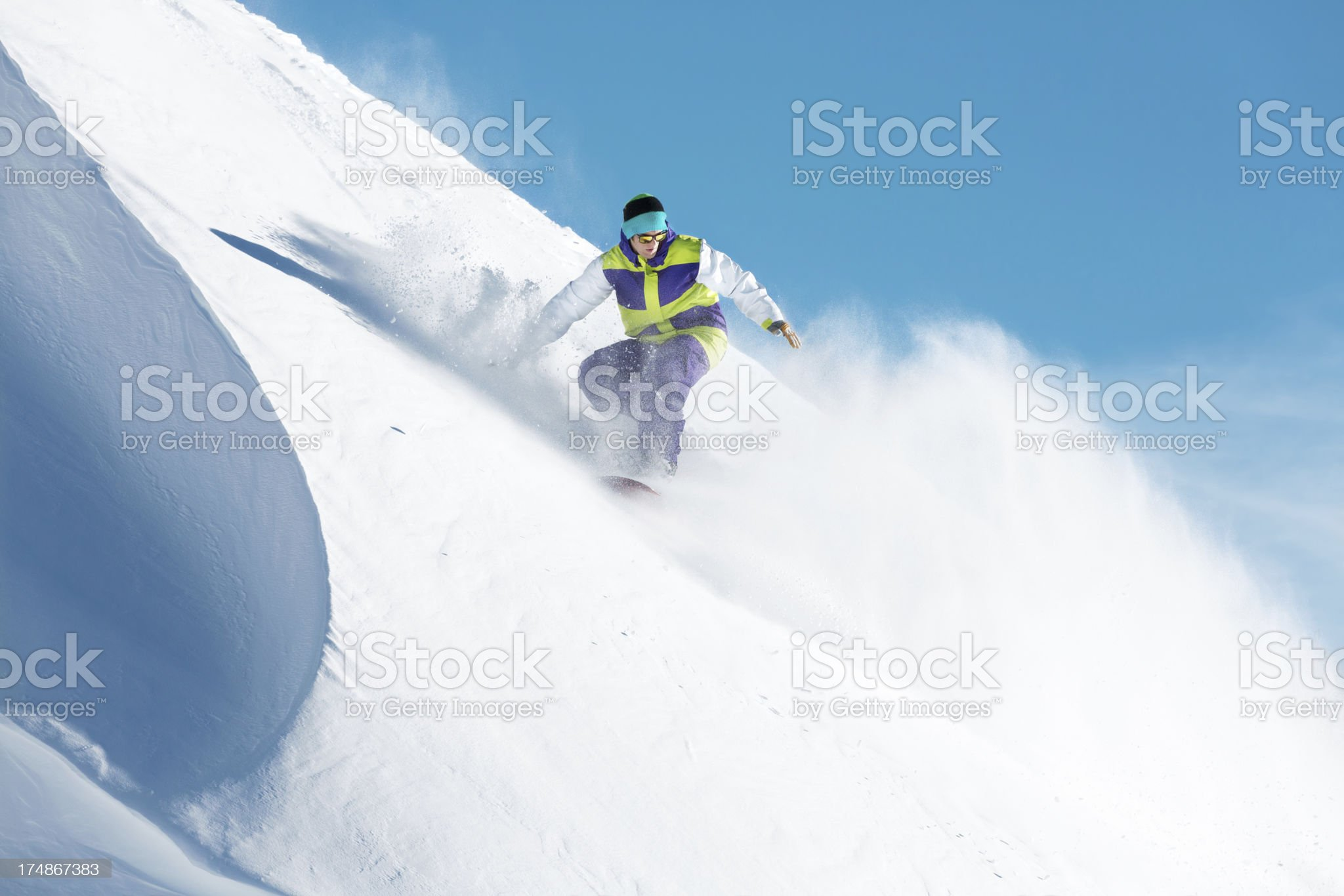 Snowboarder going downhill royalty-free stock photo