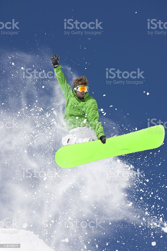 Snowboarder Grabbing Board In Extreme Jump royalty-free stock photo