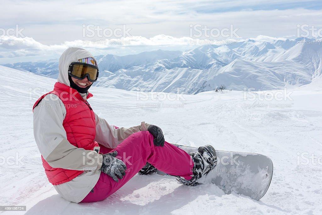Snowboarder has fun in high winter mountains in Gudauri, Georgia stock photo
